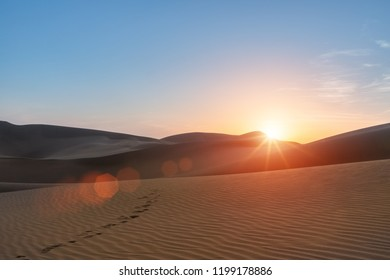 desert  landscape in sunset,beautiful setting sun and footprints in the desert