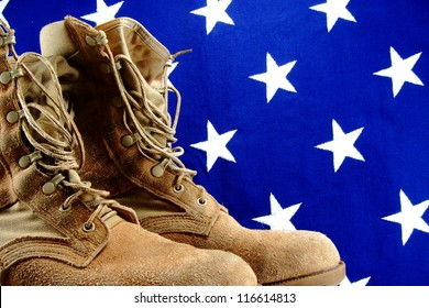 Desert military boots set against a vintage vivid cloth American flag
