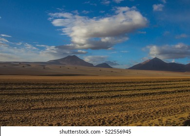 Desert and mountain over blue sky and white clouds on Altiplano,Bolivia Chile