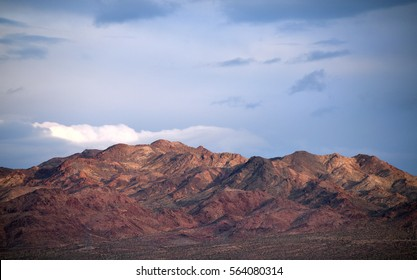 Desert mountain range with cloudy sky