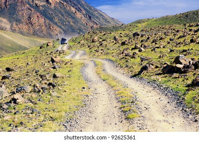 Desert mountain road and car in Mongolia