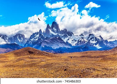 Desert and mountains. The famous ridge Mount Fitz Roy and the Patagonian prairie. Argentine Patagonia. The concept of active and extreme tourism