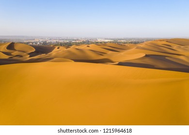 desert near the city, golden sand dunes at dusk, xinjiang