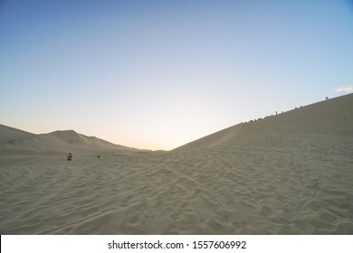 The desert oasis in Huacachina, Peru. People can play sand-boarding and have a exciting buggy tour in the desert . Huacachina is very popular to tourist. You will feel butterflies in your stomach.