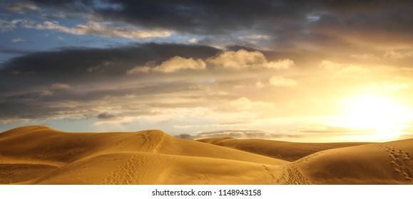 a Desert panorama of the dunes at sunset