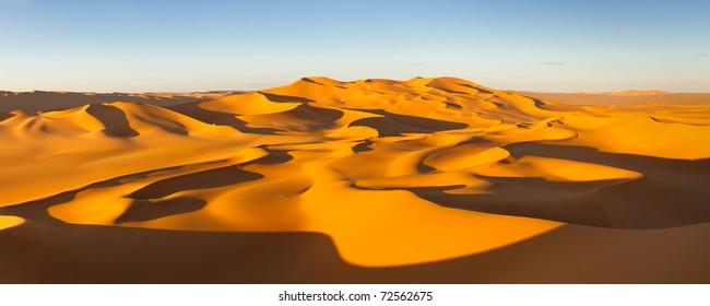 Desert Panorama - Endless sand dunes at sunset - Murzuq Desert, Sahara, Libya
