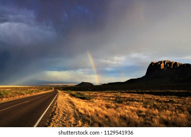 Desert rainbow and mountain off a nearby road