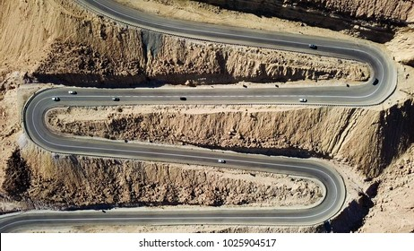 Desert road - Aerial image of traffic going up and down a  serpentine mountain road