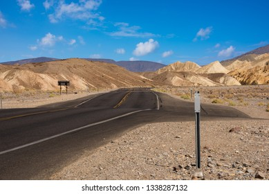 Desert road in the amazing landscape of Death Valley national park, USA