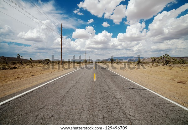 desert road in cloudy day