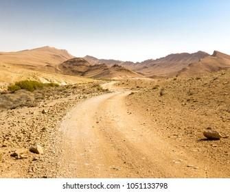 Desert road crater Arif mountains ridge cliffs scenic view landscape, travel destination nature  Negev Israel.