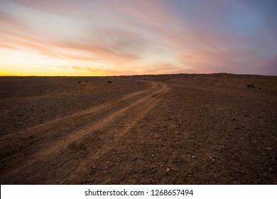Desert road in Inner Mongolia, China.Adventure travel concept.