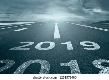 Desert road with the inscription 2018 2019. Concept of the departing old year and new goals.