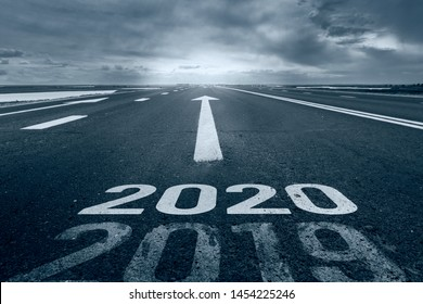 A desert road with the inscription 2019 2020. Concept of the departing old year and new goals.