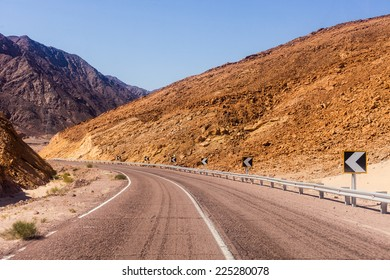 A desert road with mountains. Egypt.