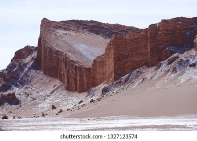 Desert rock formations. The rock layers of the Amfitheater in Valley of the Moon (Valle de la Luna), Atacama Desert, Chile