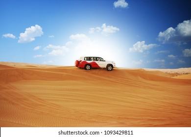 Desert safari with off road 4x4 car in sunlight