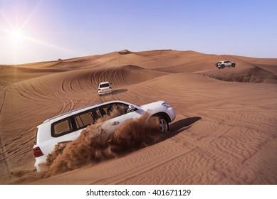 Desert Safari SUVs bashing through the arabian sand dunes