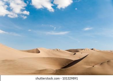 Desert Sand Dune With Blue Sky