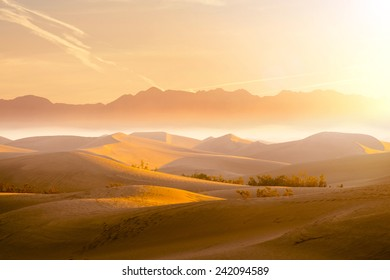Desert Sand Dunes with Beautiful Mountain View in the Background