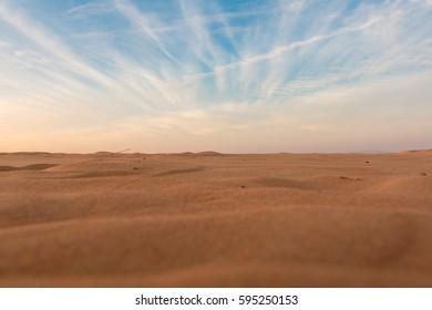 Desert sand dunes. Sand dunes at sunset.