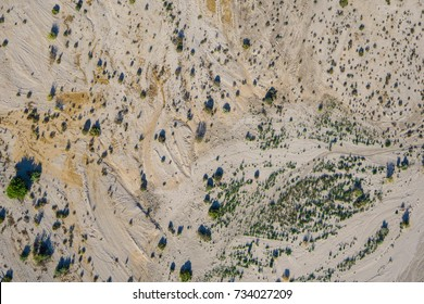 Desert sands and brush viewed from high above in American southwest.