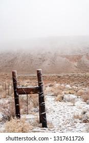 desert snow on wooden fence post Sierra Nevada valley landscape California, USA