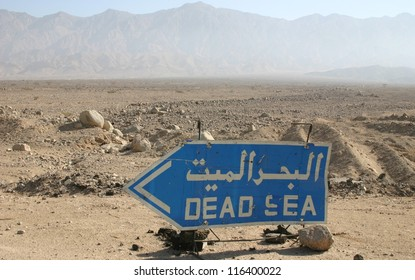 In the desert of southern Jordan a sign points the way to the dead sea