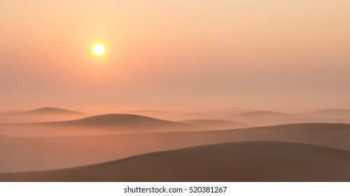 Desert sunrise with fog in Dubai, United Arab Emirates.