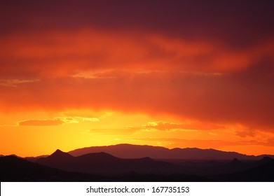 Desert sunset with bright color gradients