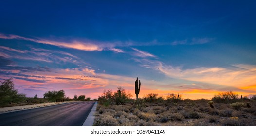 A desert sunset in Scottsdale, Arizona highlighted by a road leading to infinity.