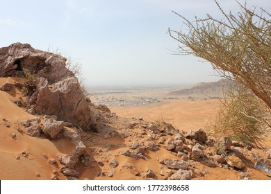 Desert terrain in Sharjah, United Arab Emirates. Wind action constantly changes the dimensions, color and texture of the inhospitable and arid terrain where summer temperatures peak above 122F/50C.