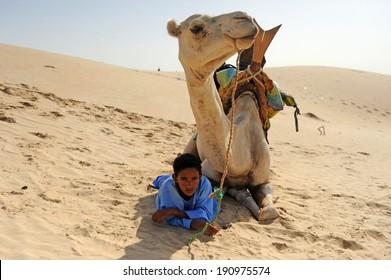 Desert Timbuktu (Mali). Sep-02-2011. Tuareg boy under his camel