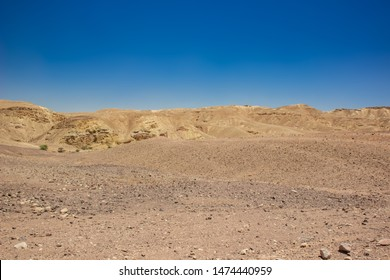 desert valley wasteland scenic landscape view of nothing with sand stone bare mountain ridge background