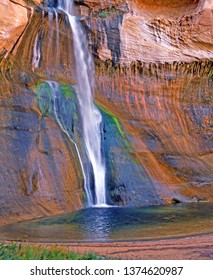 Desert Water Fall - An image of Lower Calf creek water fall cascading down the colorful sandstone wall - Location: Escalante National Monument, Southern Utah