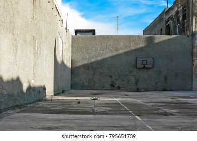 A deserted basketball court in the city.