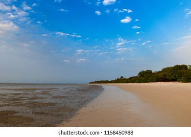 Deserted beach in the island of Orango at sunset, in Guinea Bissau. Orango is part of the Bijagos Archipelago; Concept for travel in Africa and summer vacations