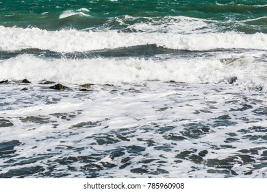 a deserted beach with waves