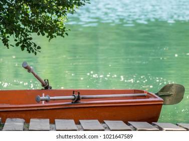 Deserted boat on lake