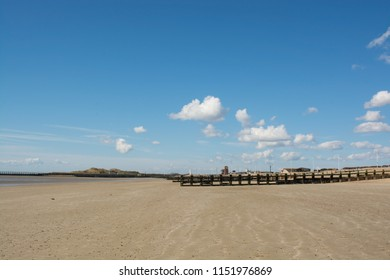 Deserted and empty sandy beach at low tide. Littlehampton, West Sussex, England