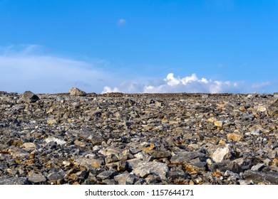 deserted flat gravelly rocky terrain under the sky