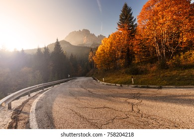 Deserted mountain road during autumn. Travel concept.