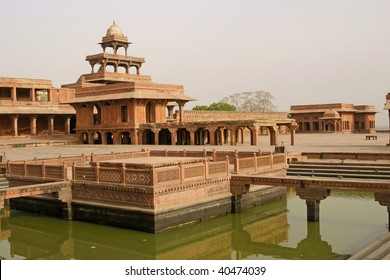 Deserted Mughal city of Fatehpur Sikri. Red sandstone buildings set around formal gardens and ornamental pool. Uttar Pradesh, India. 16th Century AD.