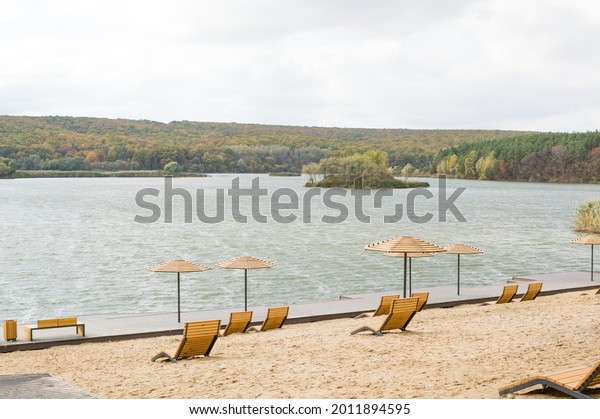 deserted-river-beach-wooden-umbrellas-60