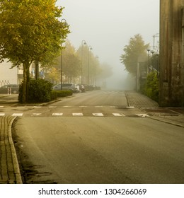 Deserted Roadway in Early Morning Mist