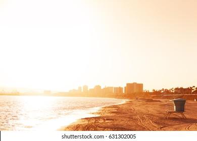 Deserted sea shore of Long Beach at sunset