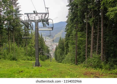 deserted ski lifts in the mountains on a rainy day