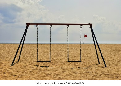 The deserted swing on a sultry day in the beach