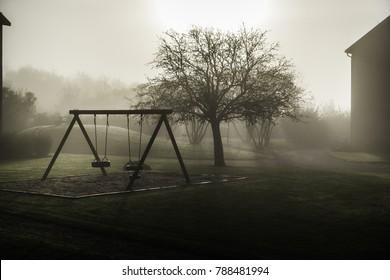 Deserted swingset in the Mist in Sweden
