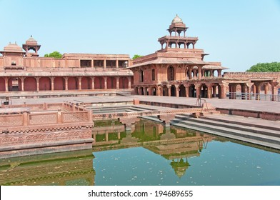 deserted town fatehpur sikri reflecting in the pond - india - rajasthan - agra